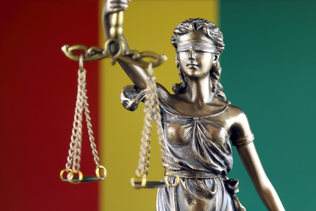Symbol of law and justice with Guinea Flag. Close up. Stock Photo