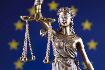 Symbol of law and justice with European Union Flag. Close up. Stock Photo