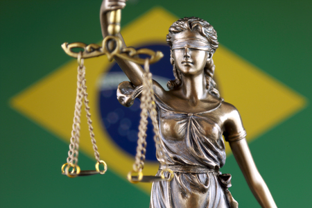 Symbol of law and justice with Brazil Flag. Close up. Stock Photo
