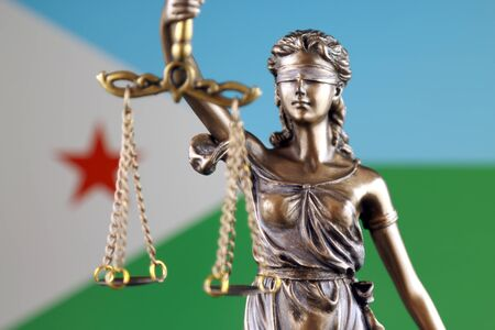 Symbol of law and justice with Djibouti Flag. Close up. Stock Photo