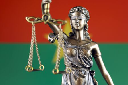 Symbol of law and justice with Burkina Faso Flag. Close up.