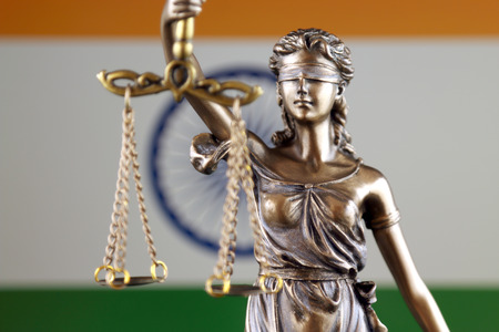 Symbol of law and justice with India Flag. Close up. Stok Fotoğraf
