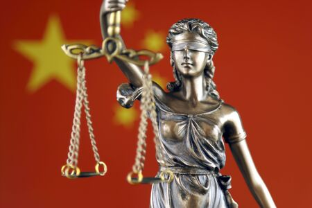 Symbol of law and justice with China Flag. Close up. Banque d'images