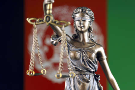 Symbol of law and justice with Afghanistan Flag. Close up.