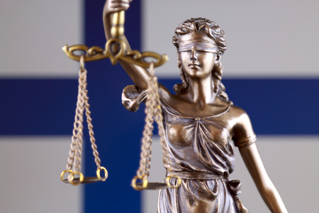 Symbol of law and justice with Finland Flag. Close up. Stock Photo