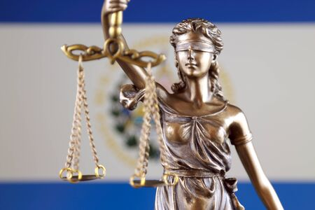 Symbol of law and justice with El Salvador Flag. Close up.