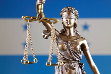 Symbol of law and justice with Honduras Flag. Close up.