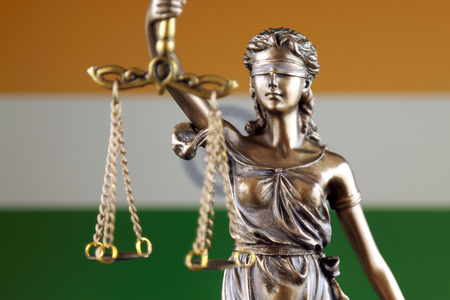 Symbol of law and justice with India Flag. Close up. Stock Photo