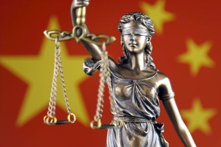 Symbol of law and justice with China Flag. Close up. Stock Photo