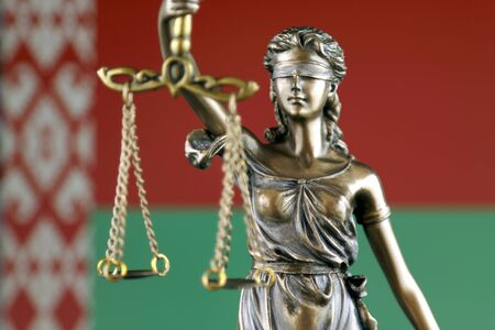 Symbol of law and justice with Belarus Flag. Close up. Stock Photo