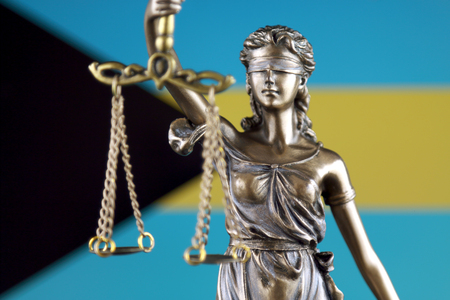 Symbol of law and justice with Bahamas Flag. Close up.