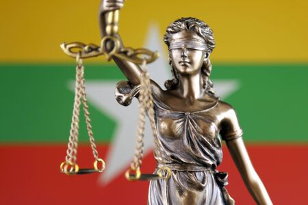 Symbol of law and justice with Myanmar Flag. Close up.