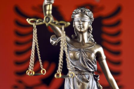 Symbol of law and justice with Albania Flag. Close up. Stock Photo
