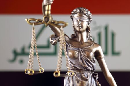 Symbol of law and justice with Iraq Flag. Close up. Stock Photo