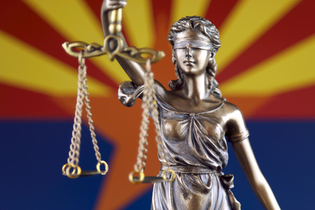 Symbol of law and justice with Arizona State Flag. Close up.