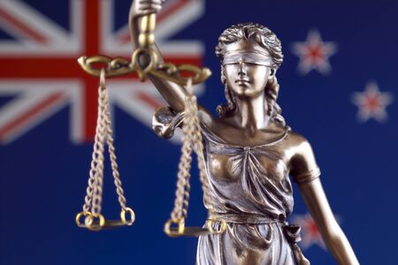 Symbol of law and justice with New Zealand Flag. Close up. Stock Photo