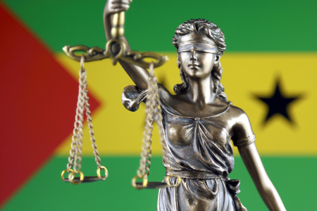 Symbol of law and justice with Sao Tome and Principe Flag. Close up.