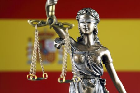 Symbol of law and justice with Spain Flag. Close up. Stock Photo