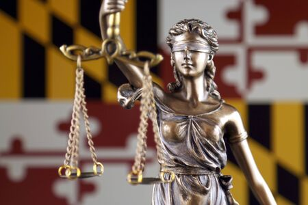 Symbol of law and justice with Maryland State Flag. Close up. Stock Photo