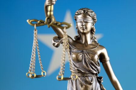 Symbol of law and justice with Somalia Flag. Close up.
