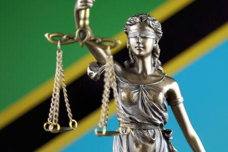 Symbol of law and justice with Tanzania Flag. Close up. Stock Photo