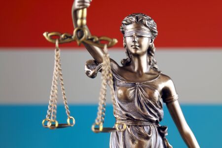 Symbol of law and justice with Luxembourg Flag. Close up. Stock Photo