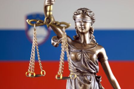 Symbol of law and justice with Slovenia Flag. Close up.