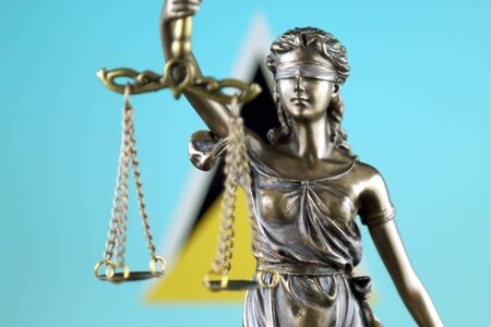 Symbol of law and justice with Saint Lucia Flag. Close up. Stock Photo