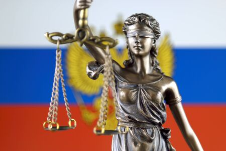 Symbol of law and justice with Russia Flag. Close up. Stock Photo