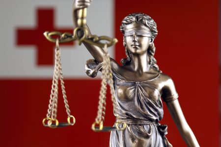 Symbol of law and justice with Tonga Flag. Close up.