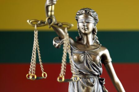 Symbol of law and justice with Lithuania Flag. Close up. Stock Photo