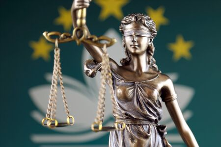 Symbol of law and justice with Macau Flag. Close up.