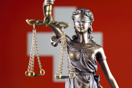 Symbol of law and justice with Switzerland Flag. Close up. Stock Photo