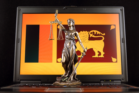 Symbol of law and justice with Sri Lanka Flag on laptop. Studio shot.