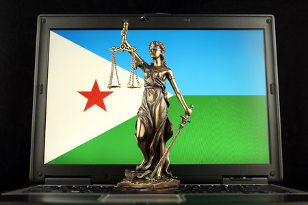 Symbol of law and justice with Djibouti Flag on laptop. Studio shot.