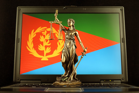 Symbol of law and justice with Eritrea Flag on laptop. Studio shot.