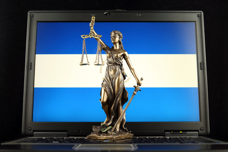 Symbol of law and justice with Nicaragua Flag on laptop. Studio shot.