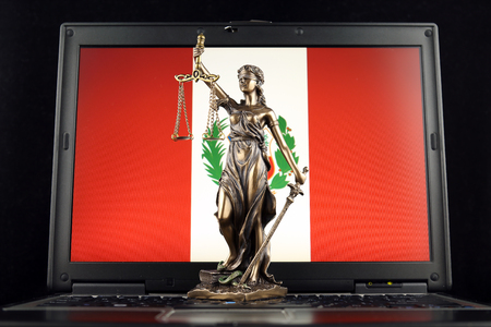 Symbol of law and justice with Peru Flag on laptop. Studio shot. Stock fotó