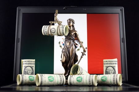 Symbol of law and justice, banknotes of one dollar and Mexico Flag on laptop. Studio shot. Stock Photo