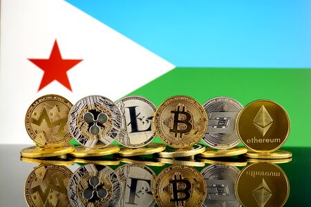 Physical version of Cryptocurrencies (Monero, Ripple, Litecoin, Bitcoin, Dash, Ethereum) and Djibouti Flag. Stock Photo