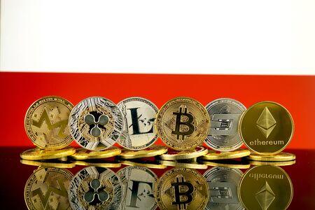 Physical version of Cryptocurrencies (Monero, Ripple, Litecoin, Bitcoin, Dash, Ethereum) and Poland Flag. Archivio Fotografico