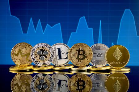 Physical version of Cryptocurrencies (Monero, Ripple, Litecoin, Bitcoin, Dash, Ethereum). Foto de archivo