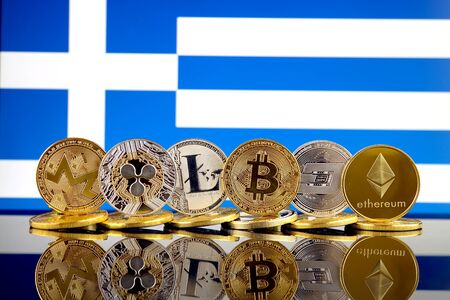 Physical version of Cryptocurrencies (Monero, Ripple, Litecoin, Bitcoin, Dash, Ethereum) and Greece Flag.