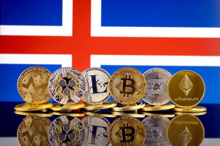Physical version of Cryptocurrencies (Monero, Ripple, Litecoin, Bitcoin, Dash, Ethereum) and Iceland Flag.