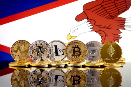 Physical version of Cryptocurrencies (Monero, Ripple, Litecoin, Bitcoin, Dash, Ethereum) and American Samoa Flag.