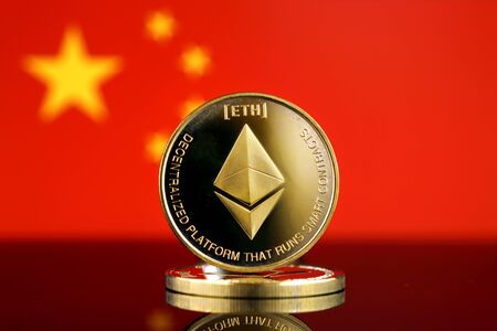 Physical version of Ethereum (ETH), new virtual money and China Flag. Conceptual image for worldwide cryptocurrency and digital payment system. Studio shot. Фото со стока