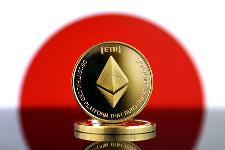 Physical version of Ethereum (ETH), new virtual money and Japan Flag. Conceptual image for worldwide cryptocurrency and digital payment system. Studio shot.