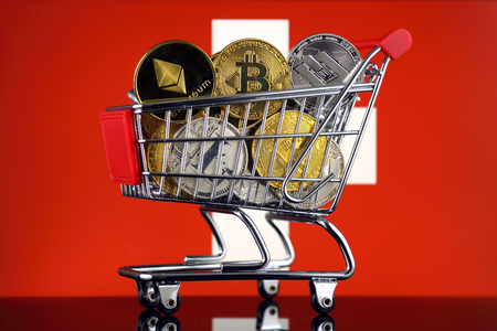 Shopping Trolley full of physical version of Cryptocurrencies (Bitcoin, Litecoin, Dash, Ethereum) and Switzerland Flag.