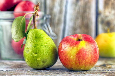 Fresh, real apple and pear from organic farming, ecological harvest on wood background. Standard-Bild