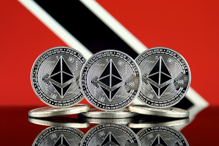 Physical version of Ethereum (ETH) and Trinidad and Tobago Flag. Conceptual image for investors in cryptocurrency, Blockchain Technology, Smart Contracts, Personal Tokens and Initial Coin Offering.
